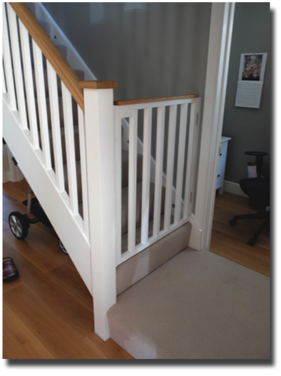 completed stairgate - painted softwood with Oak top rail
